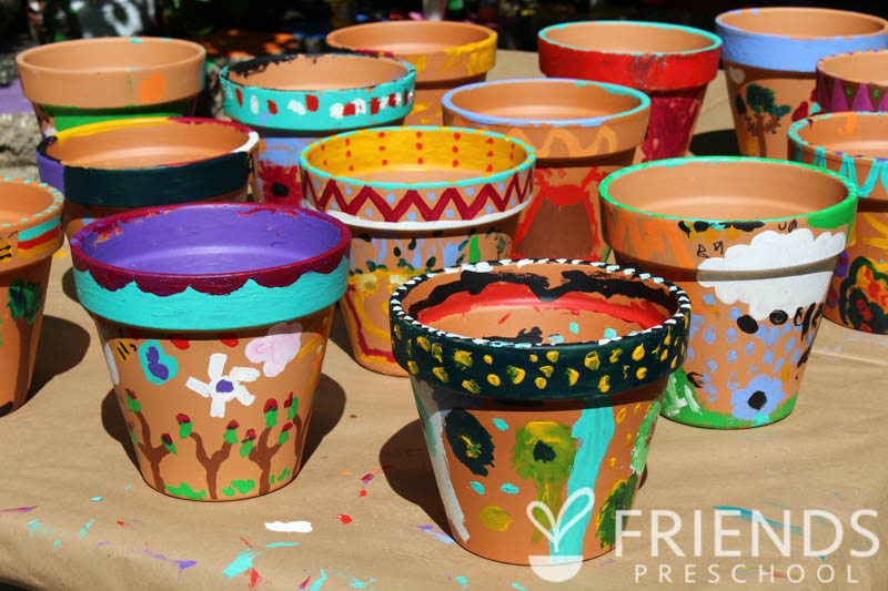 Pots painted by students and families